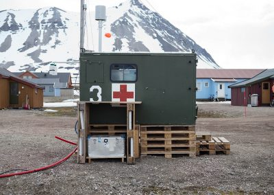 """Arctic Red Cross"", Ny Alesund, Spitzberg Island, Northest Arctic Village, © Loïc Dorez."