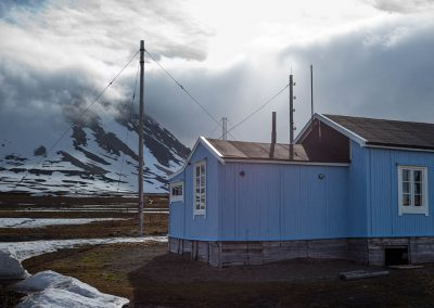 """The blue arctic house"", Ny Alesund, Spitzberg Island, Northest Arctic Village, © Loïc Dorez."