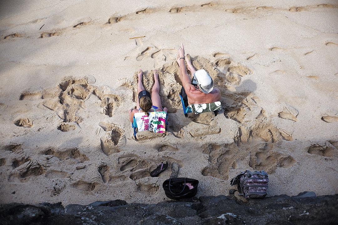 """Wave watcher"", street photography on the beach, © Loïc Dorez."